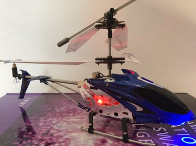 Operate a Syma S107G Remote Control Helicopter with an